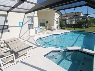 Pool and Spa with views over open area. Pool Chairs / Loungers provided.