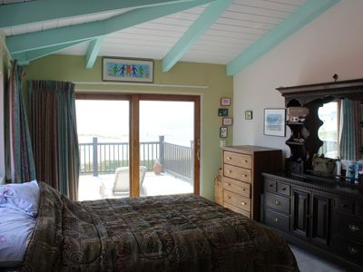 Master bedroom. The ocean view is overexposed in the sun so you can see inside.
