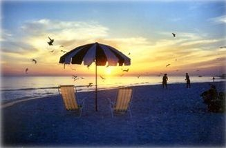 Your chairs and umbrella to watch the sunsets. Beach Volleyball court