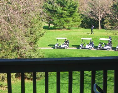 Traverse City condo rental - Watch from the balcony as golfers hack drives.
