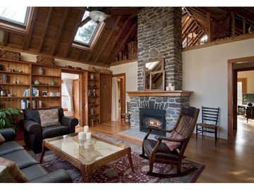 Woodstock house rental - The living room is spacious + light with skylights + a massive stone fireplace