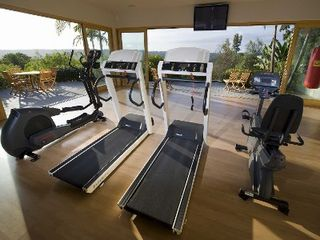 Rancho Santa Fe estate photo - Gym with slide doors for view of the ocean, valley and mountains.