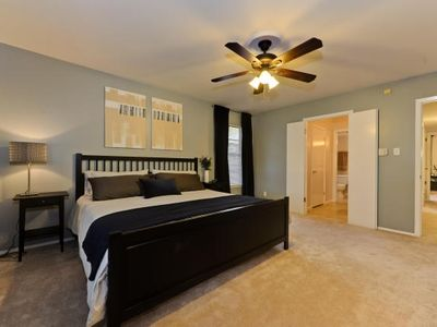 Austin house rental - Master Bedroom with King Bed, Door to Deck and Hot Tub, Bathroom & Dressing Area