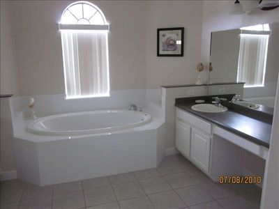 Master ensuite with bathtub, oversize shower, two dressing areas and separate wc