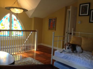 Upstairs family room with day bed and trundle bed.