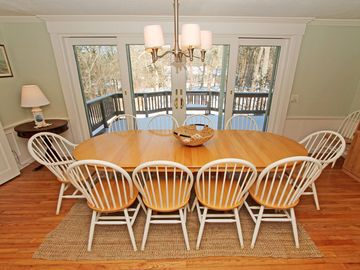 Dining room with double sliders to back deck.