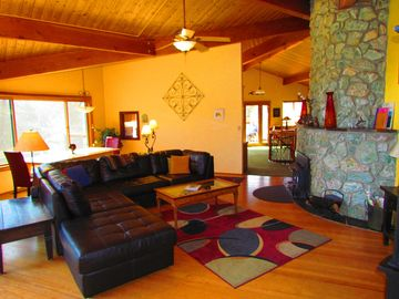 Mariposa house rental - Custom granite fireplace, living room and dining area in background.