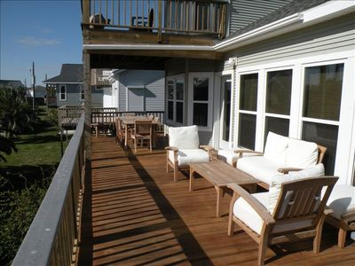Outdoor seating on the deck outside of the main living area