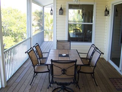 Screened in porches for dining al fresco and enjoying the Gulf breezes!