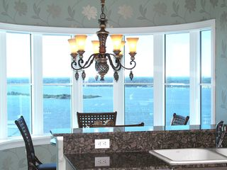 Daytona Beach Shores condo photo - Dining room with breathtaking view of the city and inter coastal waters