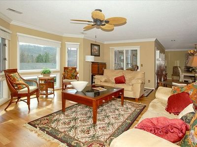 Flat Rock condo rental - Living room offers large windows and opens to dining room