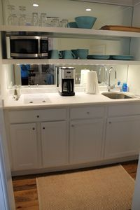 Small kitchen with 2 burner cooktop, Subzero fridge/freezer with ice maker