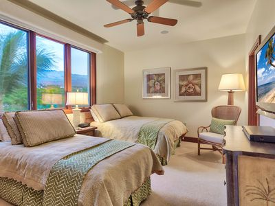 Third bedroom with full bed, twin bed, ceiling fan, and views of Haleakala