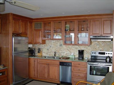 Newly remodeled kitchen with beautiful hardwood cabinets and granite counters!