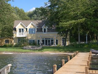 Oconomowoc house photo - Perfect sand swimming frontage and sunsets await you- privacy and tranquility