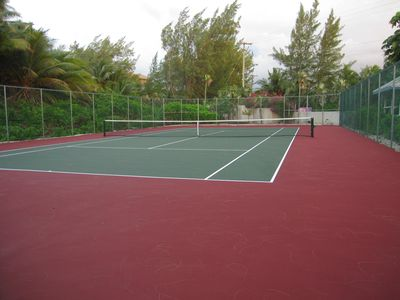 Newly resurfaced tennis court. Tennis rackets for your use in our condominium.
