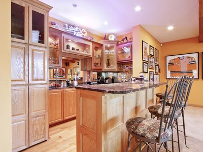 Tellico Lake estate rental - downstairs bar with ice maker and mini fridge