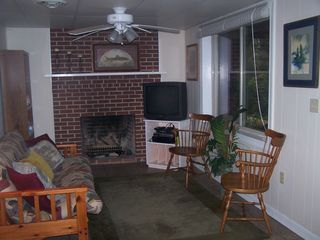 Claytor Lake house photo - Downstairs TV area with Queen size futon. Door to outside and lower deck ares