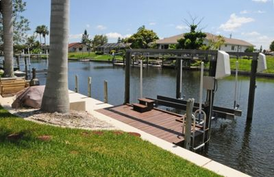 Dock and Boat Lift (8,000 Lbs). The Grill and Another Dining Area are Adjacent