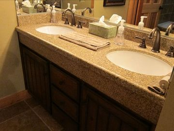 "Double sinks in Master Bathroom; carpet in this area was replaced by 18"" tile"