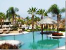 Lagoon pool, lounge seating and tiki bar - Los Cabos condo vacation rental photo