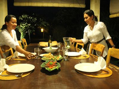 Ketut and Kadek serving dinner st villa Semadhi