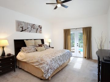 Master Suite with American King Size bed & luxurious bed linen with french doors