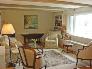 Orleans house photo - Lovely and spacious living room offering panoramic water views.