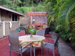 Sunset Beach house photo - Spacious side lanai with outdoor dining and plenty of seating.