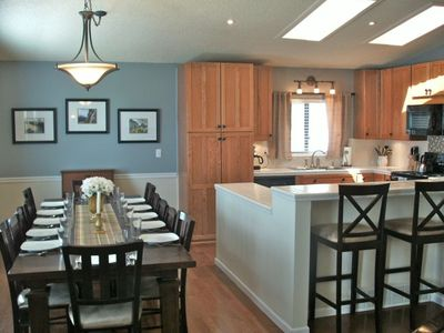 laugh together while enjoying a fully equipped kitchen