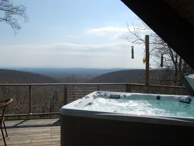 Relax in new hot tub gazing out at the mountain views and wildlife.
