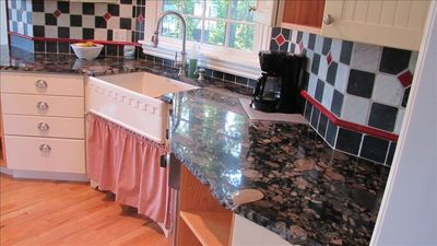 Eat in kitchen and granite counters with farmhouse sink