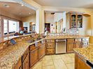 Kitchen - A double sink and abundant granite counter space make it easy to prep meals.