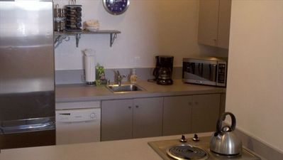 Small kitchen but fully equipped for cooking and eating at home. Dishwasher, too