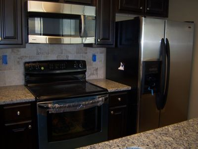Stainless steel appliances with granite counter tops