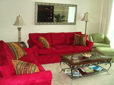Relax and enjoy entertainment center in beautifully decorated living area.
