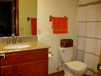 A full bathroom with a tub & shower is located across from the third bedroom.