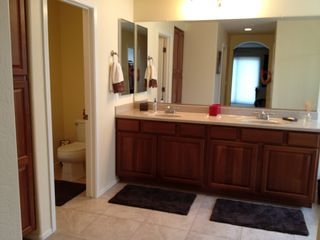 Peoria house photo - Double sinks in master bath, medicine cabinet with mirror, his & hers closet