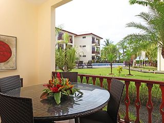 Jaco condo photo - Terrace with dining set and garden/ pool views