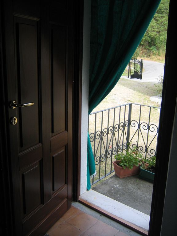 Front door (with view of gated driveway)