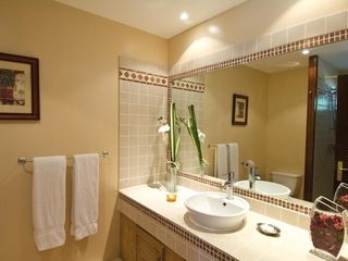 Orient Bay studio photo - The private bathroom is beautifully tiled, and has a stall shower