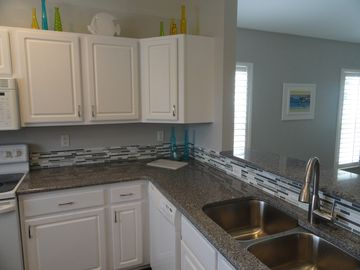 Amazing kitchen with new quartz countertops, deep stainless sinks, dishwasher!
