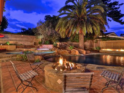 Fire-pit, outdoor television, lounge chairs are the perfect resort retreat.