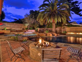 Carlsbad house photo - Fire-pit, outdoor television, lounge chairs are the perfect resort retreat.