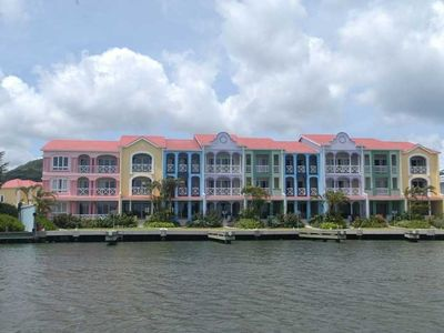 The Harbour Water-front. Villa 14a is the ground floor of the large pink bldg.
