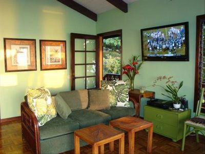 Living room and front door entrance to your private home! Satellite TV on wall.