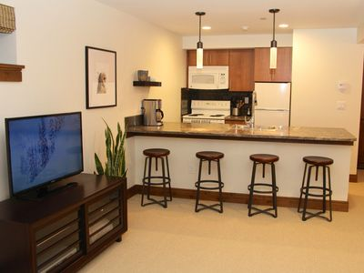 Vail house rental - The second kitchen has room for four at the granite breakfast bar