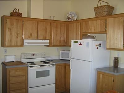 Our kitchen is fully equipped with cookware, dishes, and appliances.