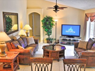 "The family room with 55"" TV, PS4 and enhanced cable sports package"