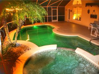 Sunridge Woods villa photo - Pool area at night